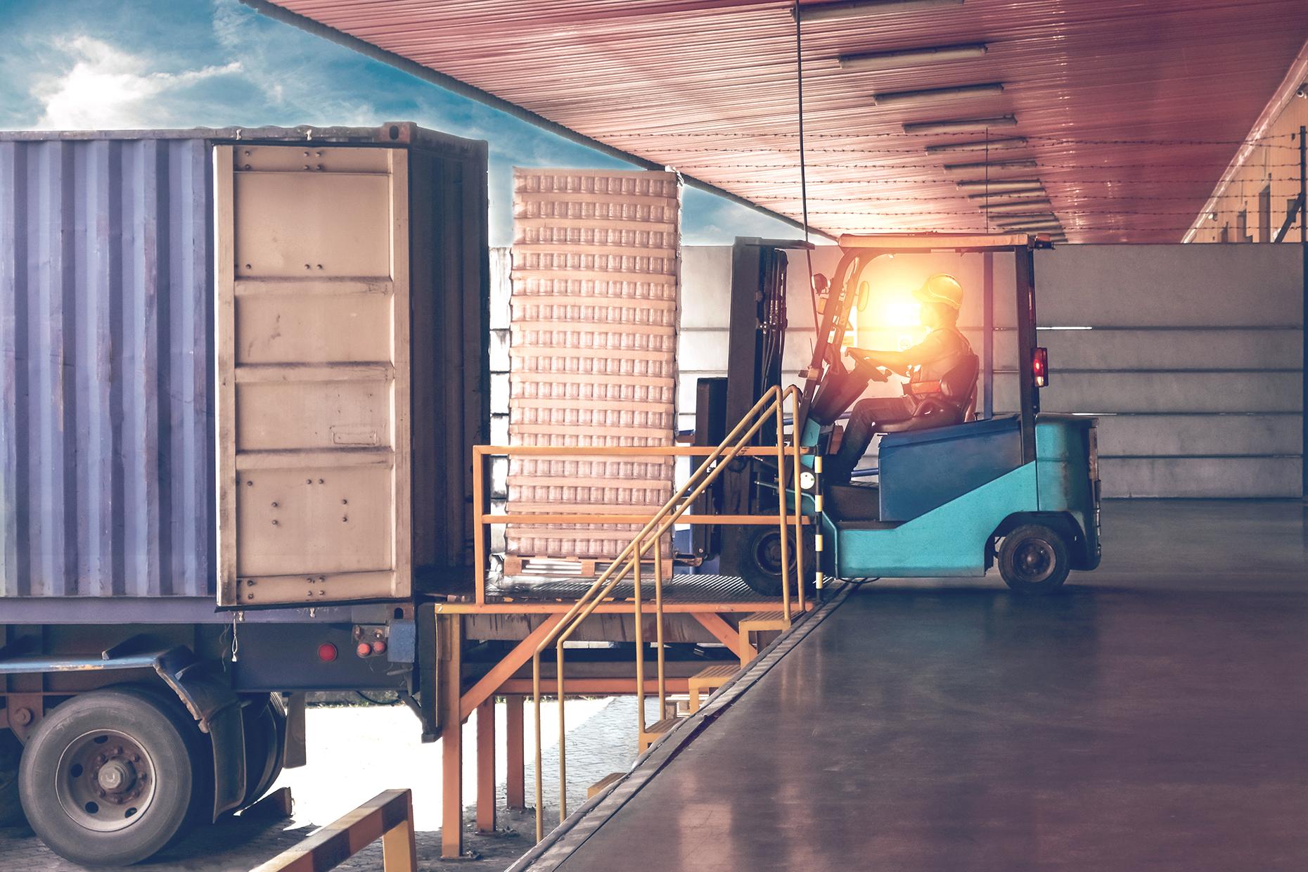 Forklift loading Semi truck trailer