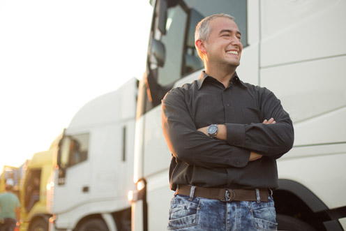 trucker crossed arms happy secured with insurance