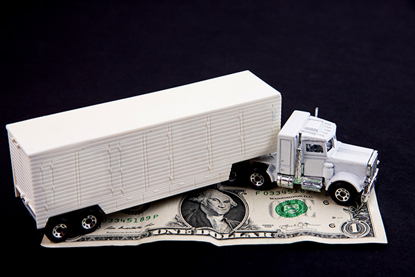 trucker shaking hands with insurance company agent