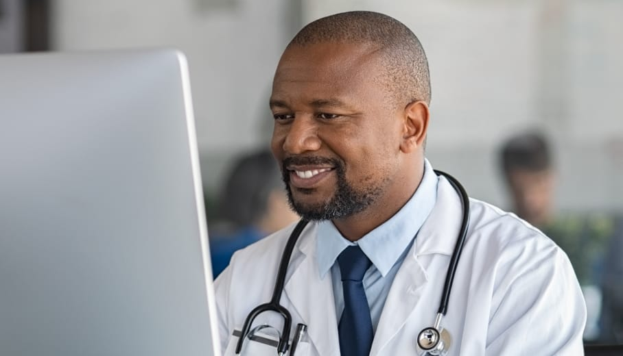 Doctor checking patient data on a computer