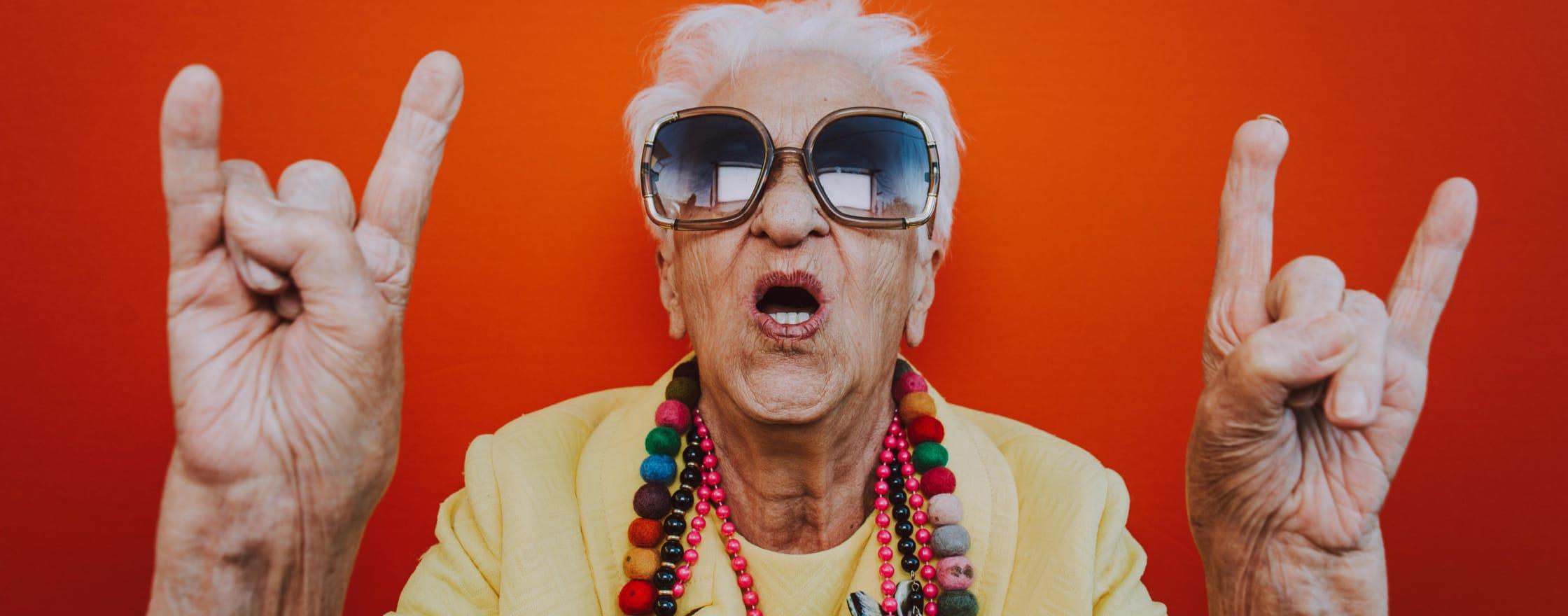 Rockstar grandma throwing up horns