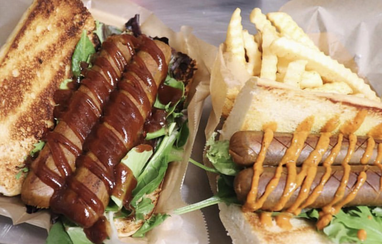 Soy Sausage Po' Boy comes with lettuce, pickles, tomatoes, & your choice of sauce, loaded on top of a French roll or Texas toast. (veget)
