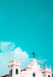 an image of a steeple against a blue sky