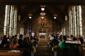 Image of congregation members in a church worshiping.
