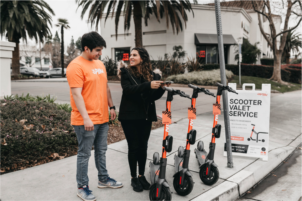 Women using the Spin Scooter valet service