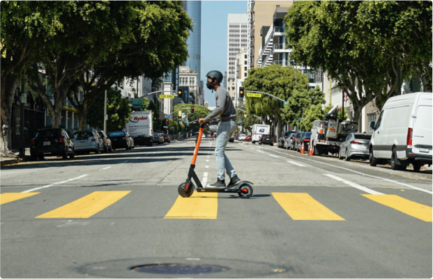 Photo of a man riding a Spin scooter