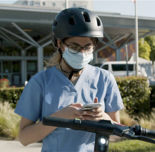 A nurse accessing a Spin Scooter via the Spin App