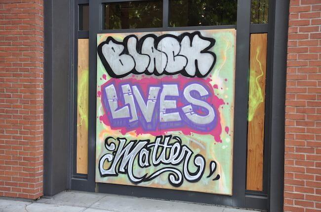 Black Lives Matter mural on boarded up door