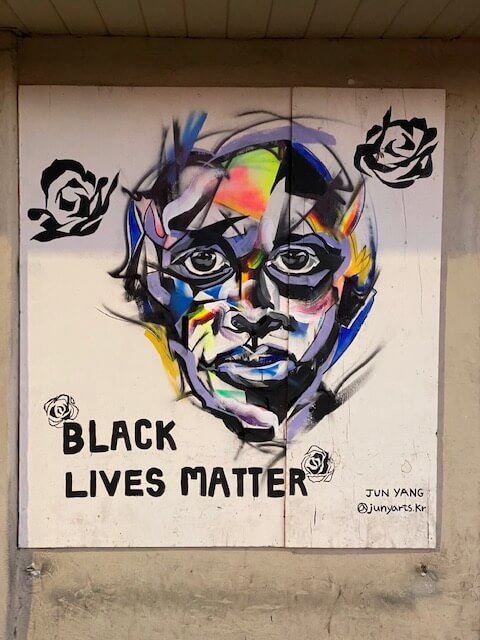 BLM mural on side of building