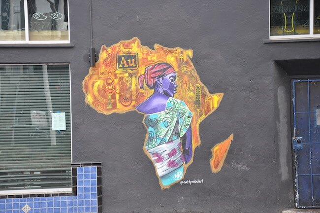 Racial justice street art on side of building