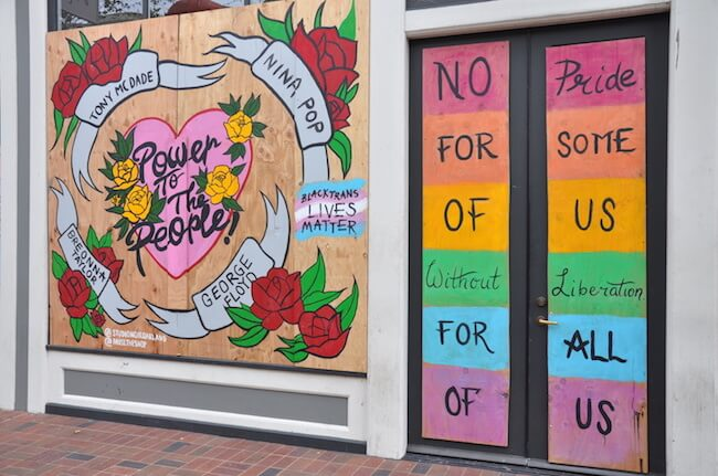 Human rights mural on a boarded up building