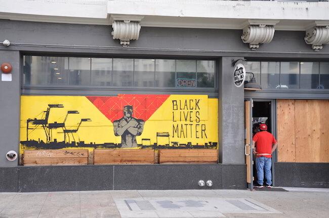 Black Lives Matter street art on boarded up building
