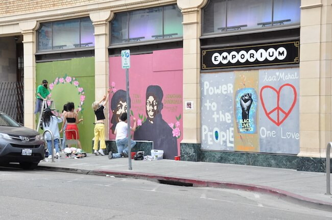 Racial justice street art on boarded up building