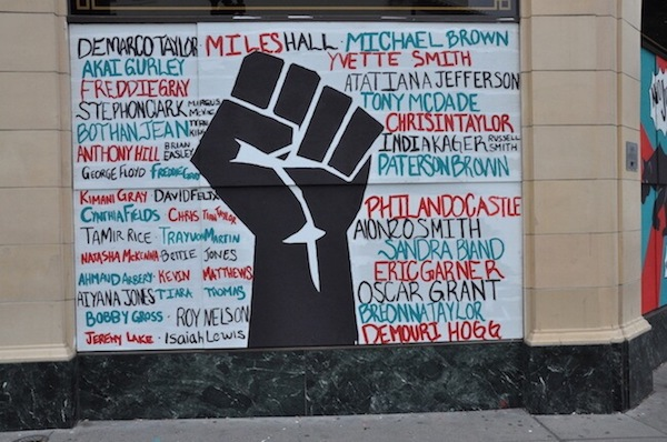 BLM mural on boarded up building