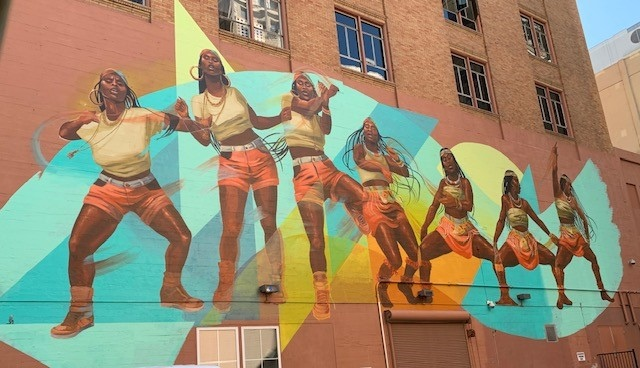 Racial justice mural on side of building