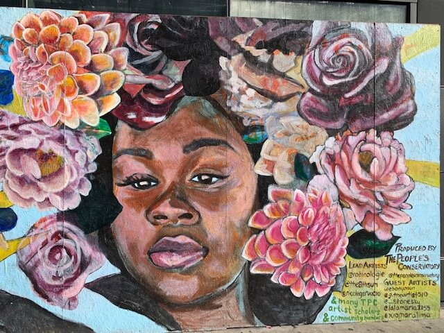 Breonna Taylor with flower crown mural
