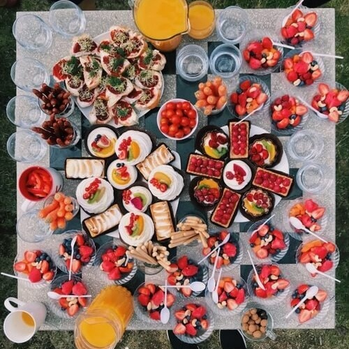 Colorful food, mainly strawberries, on plates, on the table