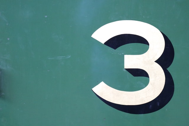 A three-dimensional numeric 3 on a green background.