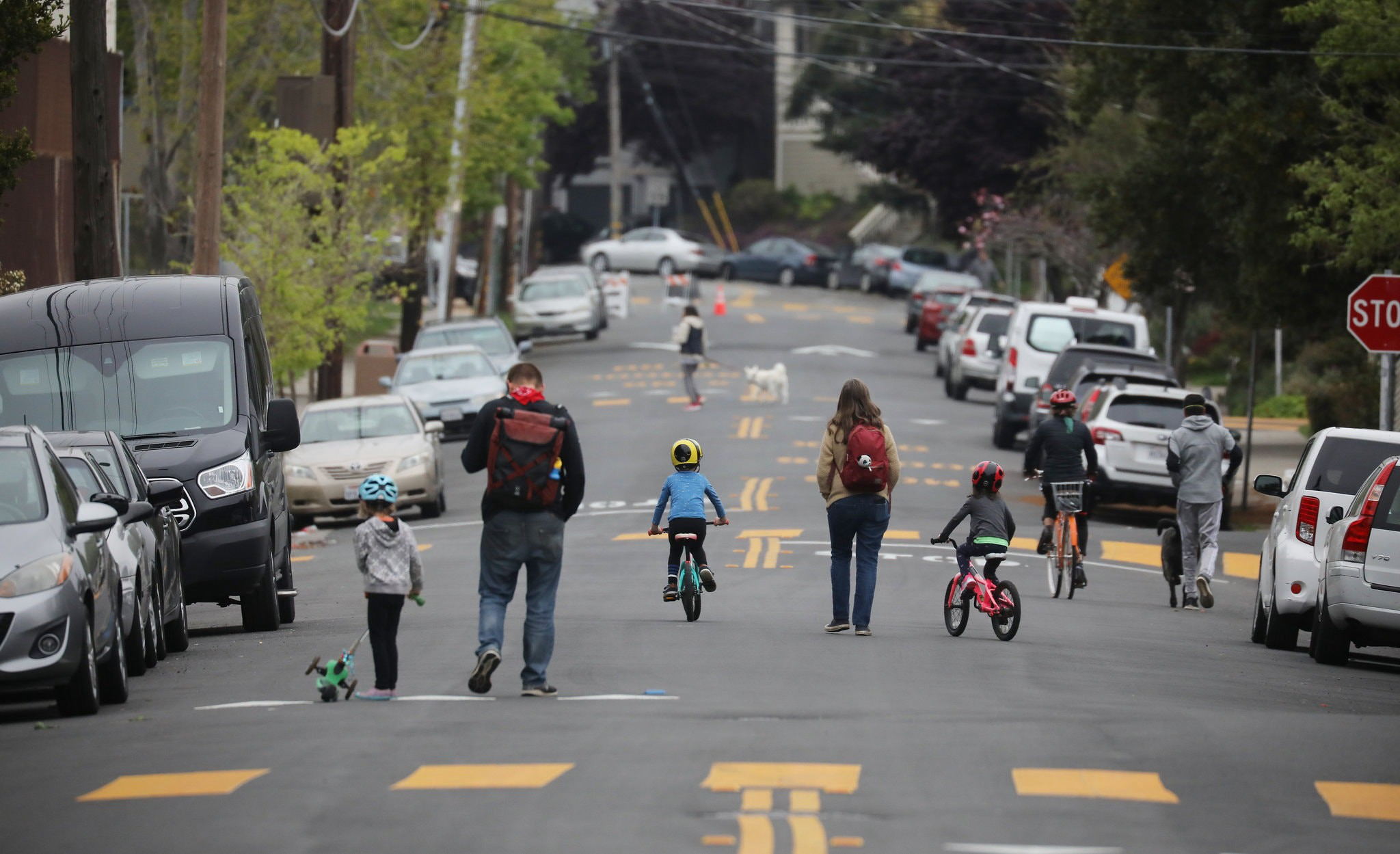 Families walking together safely on open streets during stay-home orders