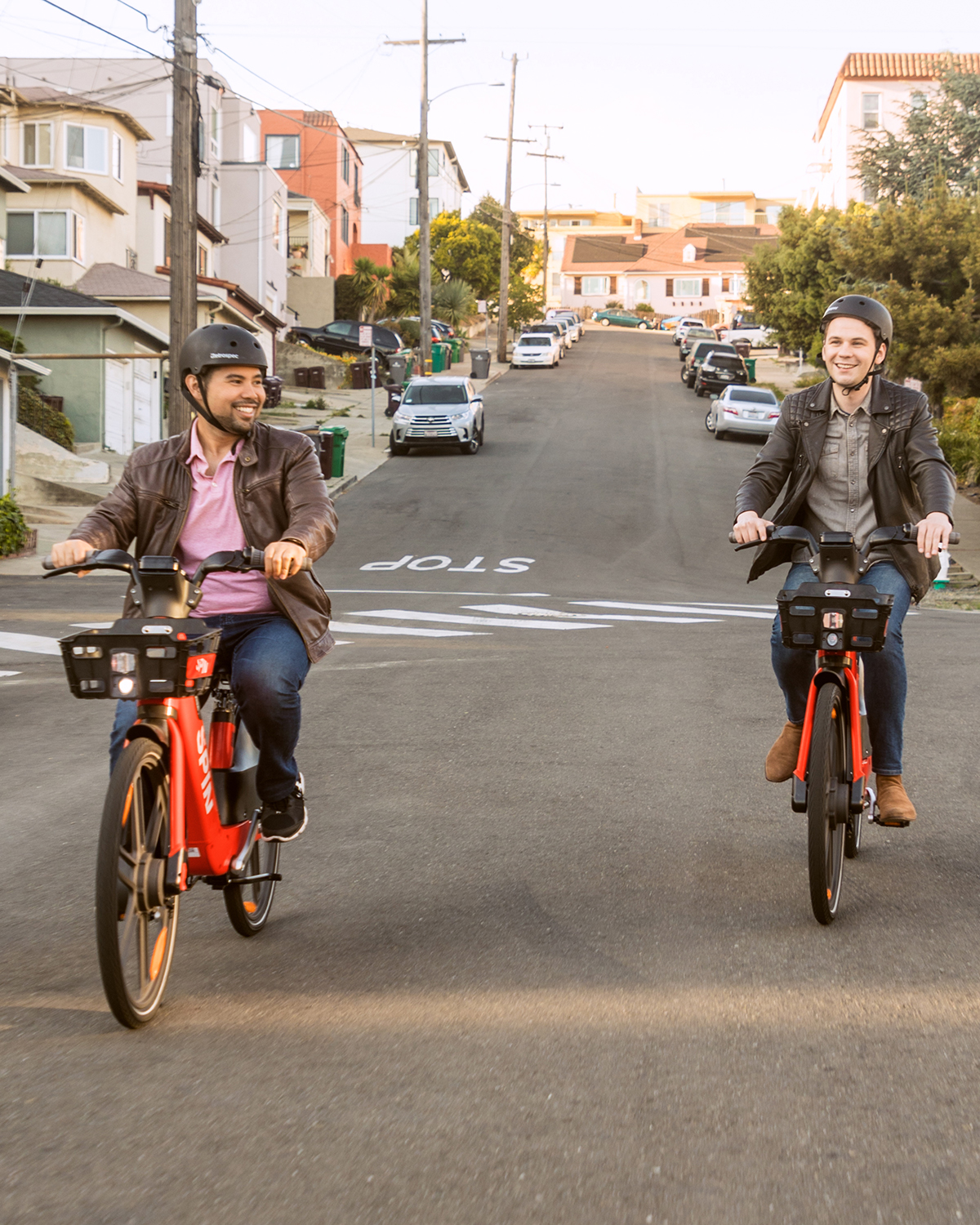 One person riding an e-scooter and one person riding an e-bike.