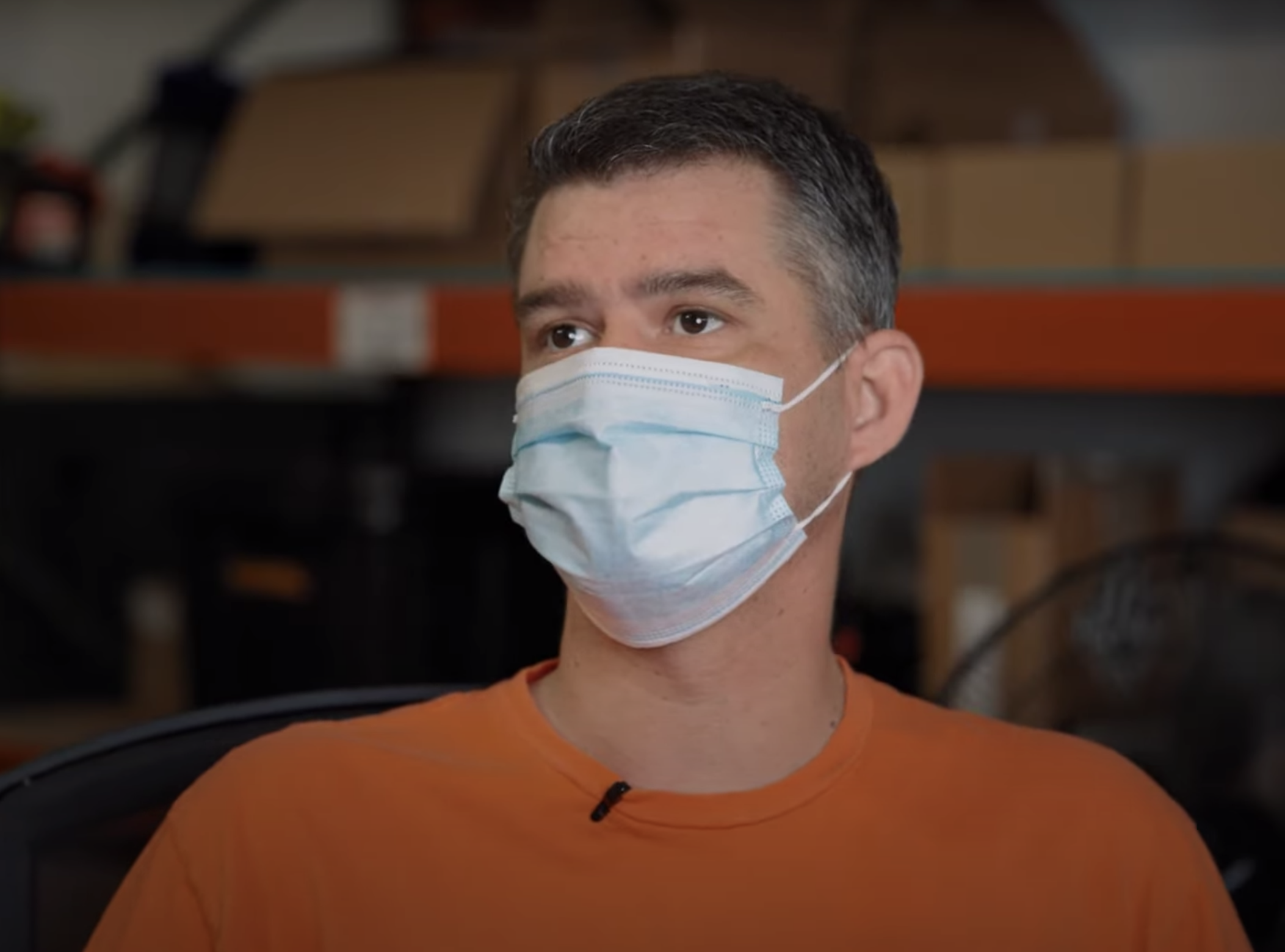 A photo of a man, James C., wearing a face mask.