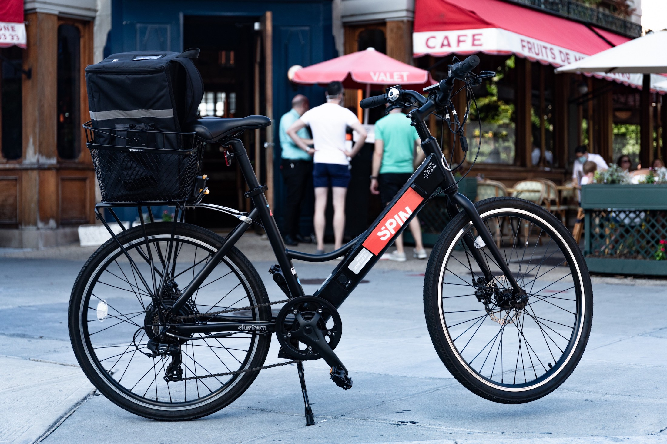 A bike in front of outdoor dining