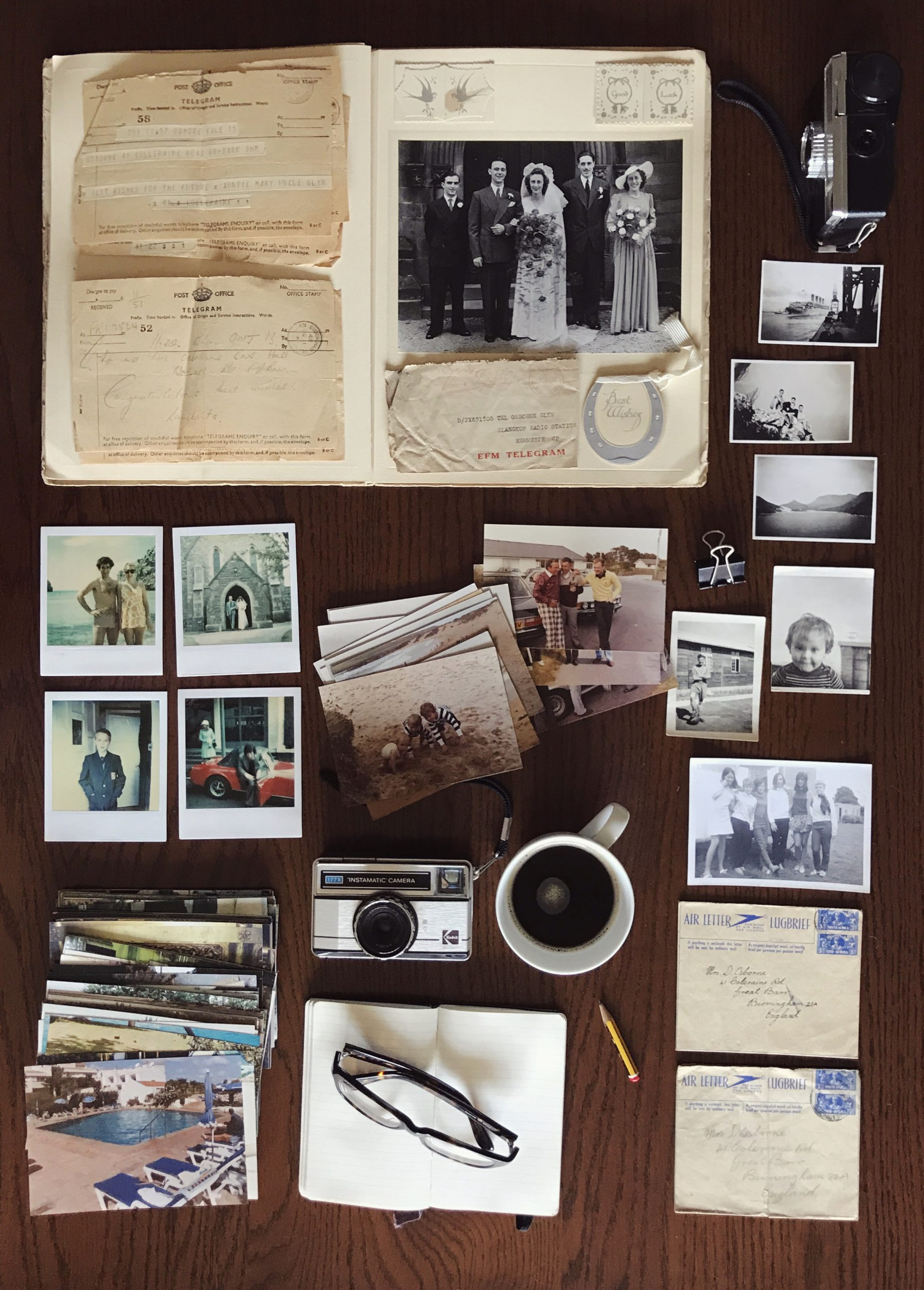 Image depicting a selection of vintage photos, photographic memorabilia, old camera and other items to be scanned.