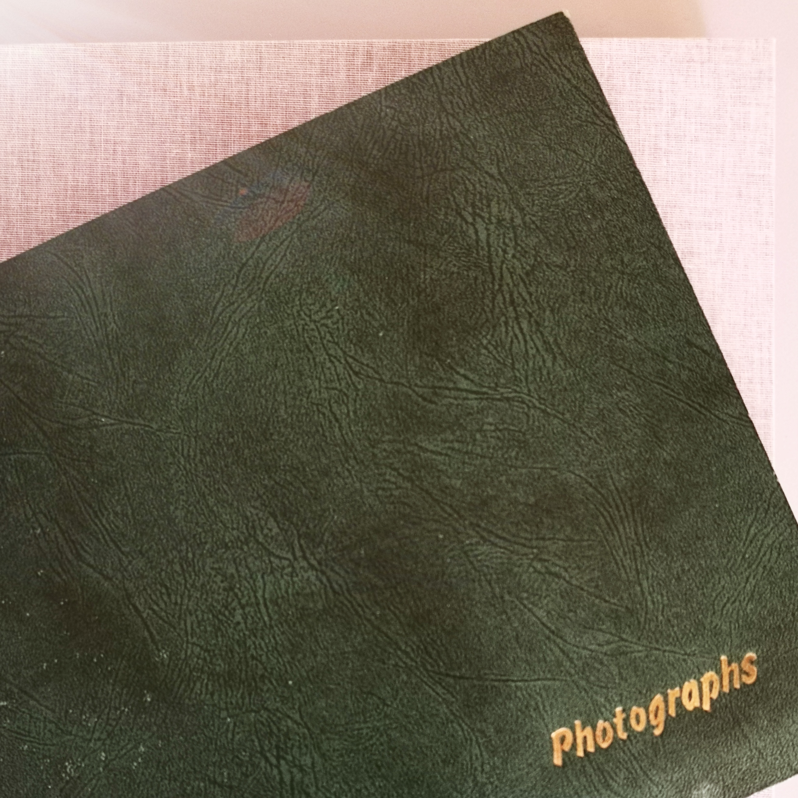 Image of an old photograph albums, illustrating the album scanning service on offer.