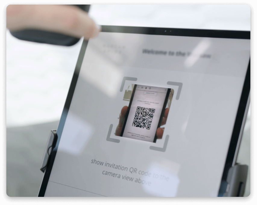 Scanning the QR code by the visitor to check in