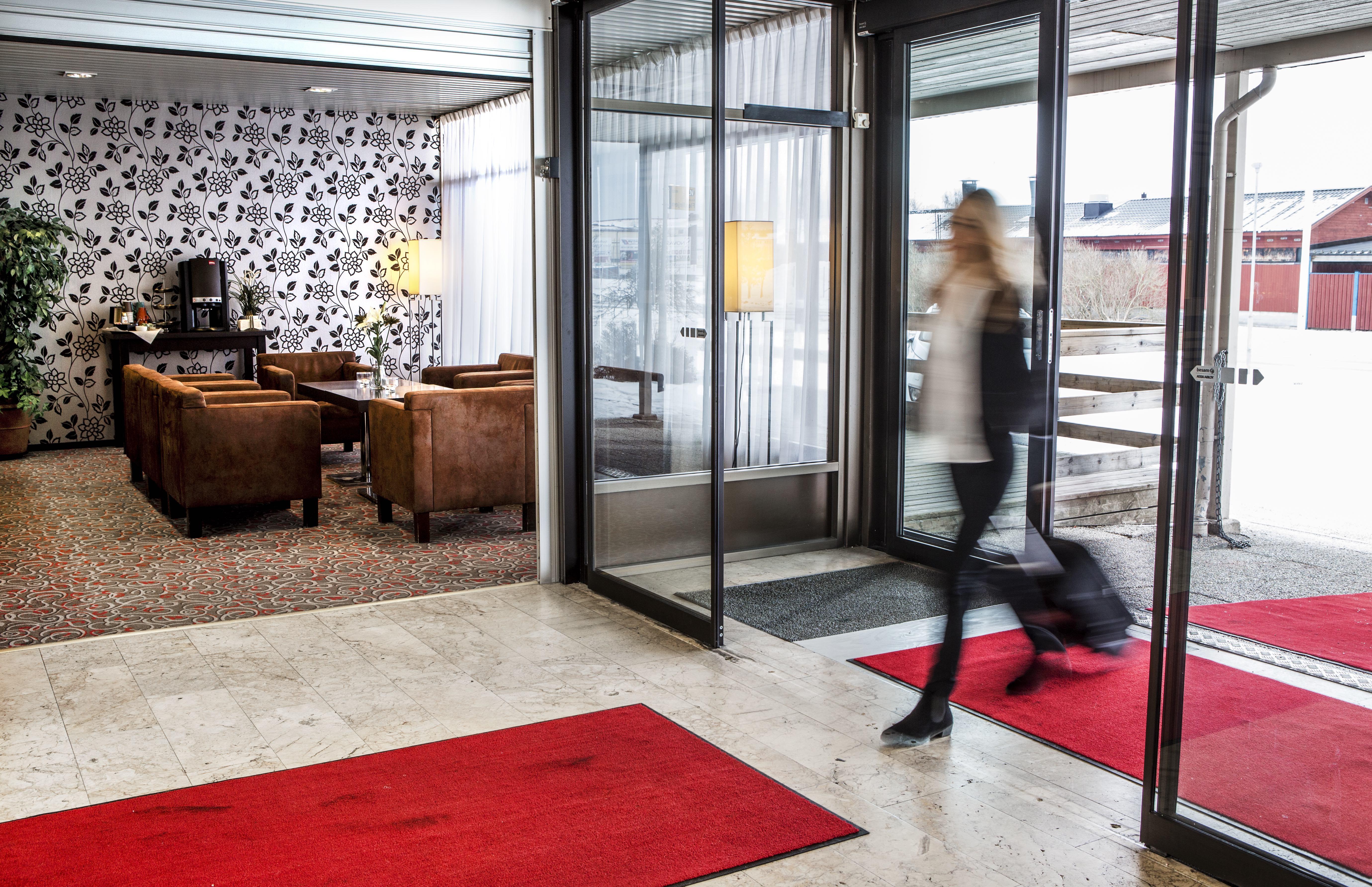A business woman walking inside Hotel Scheele.