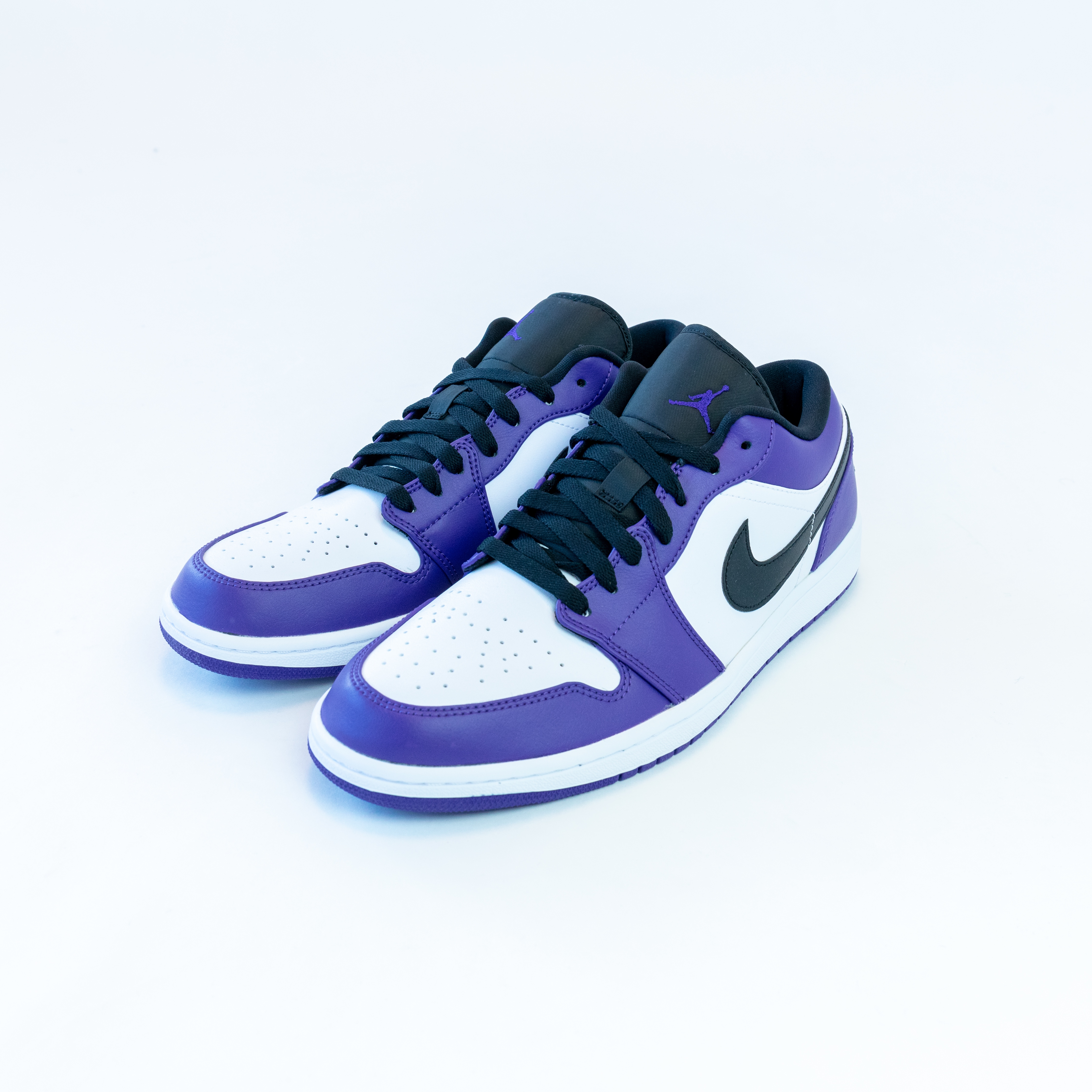 Product picture for Decked Out featuring a pair of purple Jordan shoes.