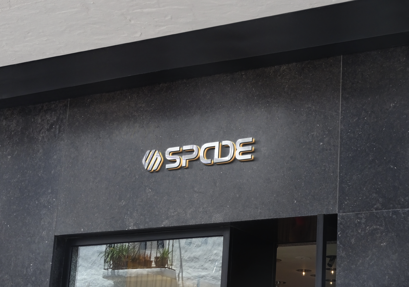 The Spade logo on a concrete wall.