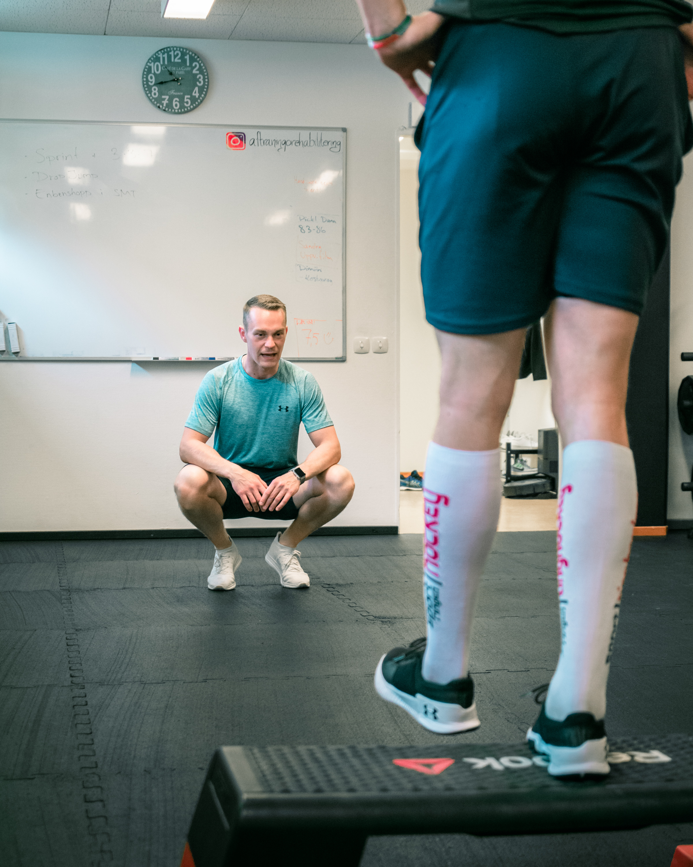 An image featuring Alfons in his gym instructing a professional athlete.