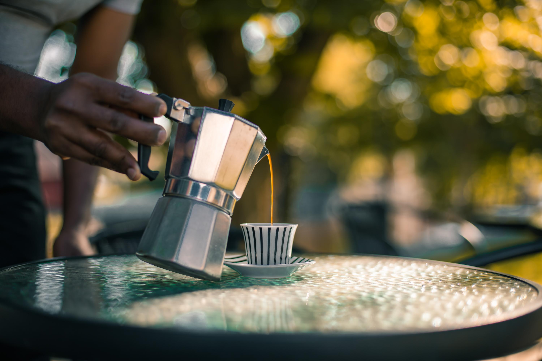 A man pouring Eritrean Coffee into a cup.