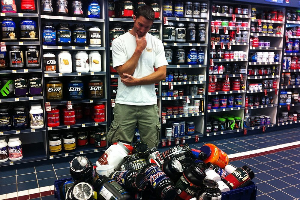 man choosing food supplements