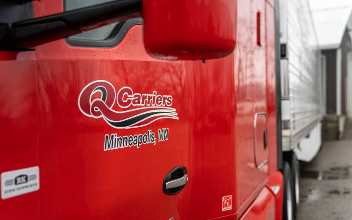 qcarriers logo on a door of a truck