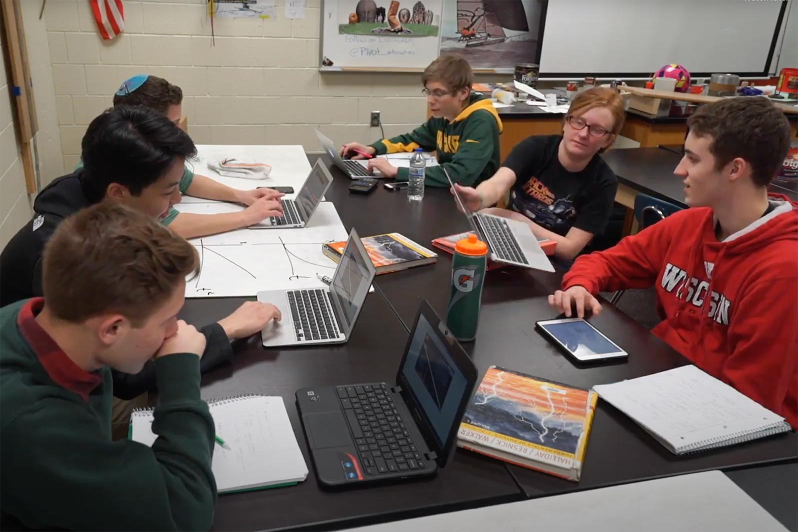 Students using Pivot Interactives to collaborate in a classroom