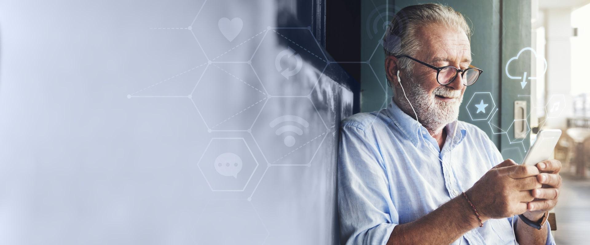 Elderly male using a phone