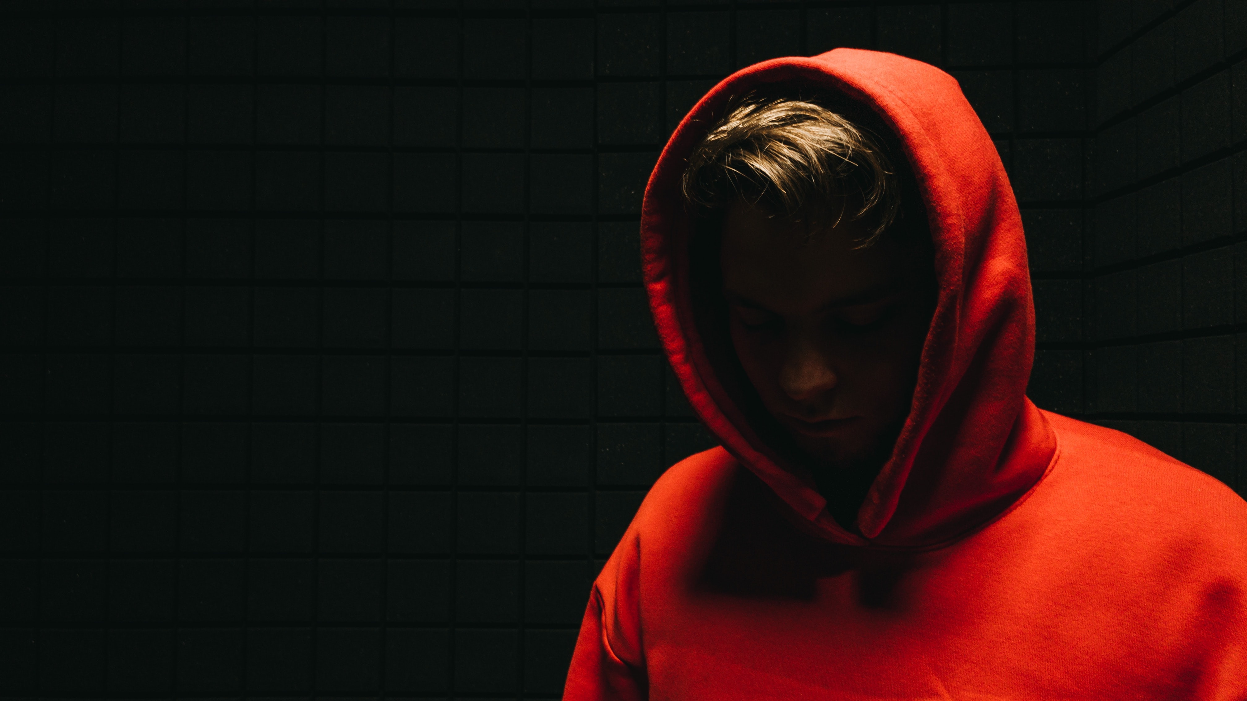 Male in a red hoodie