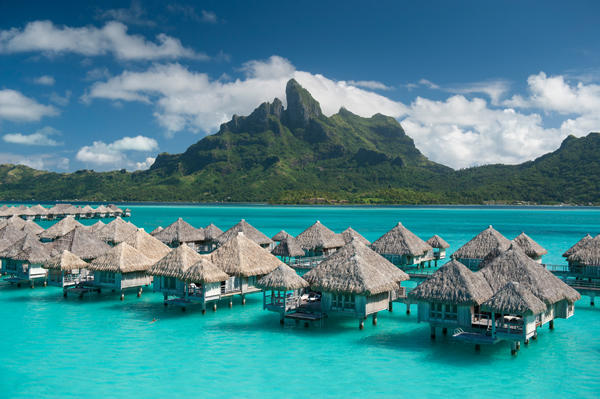 The gorgeous overwater bungalows surrounded by crystal clear turquoise waters with the majestic Mt. Otemanu on the horizon.