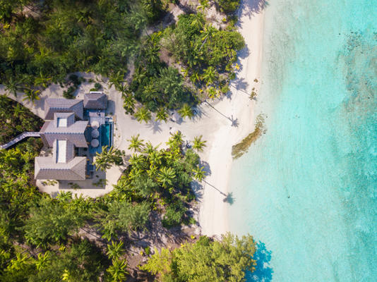 Top aerial view of The Brando's Teremoana Residence accommodations with its own private beach access.