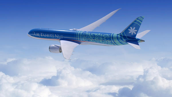 The Air Tahiti Nui's Dreamliner soaring above the clear blue skies of the Tropical Islands of Tahiti and Bora Bora.