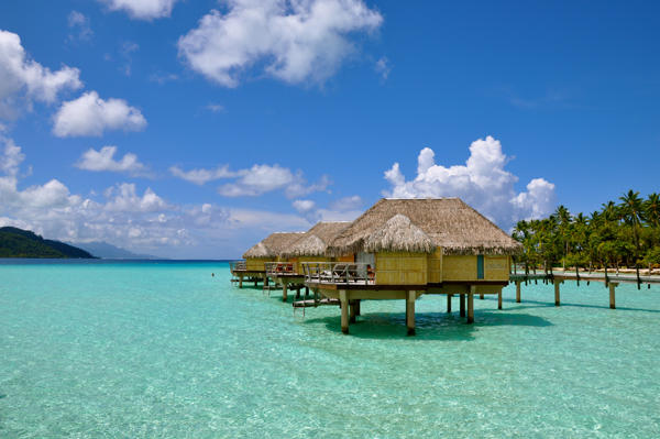 A gorgeous view of the overwater bungalows surrounded by crystal clear blue turquoise waters of Bora Bora.