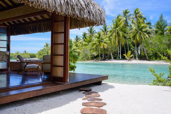 Gorgeous setting of Vahine Island Resort's Fare Spa located alongside their beautiful lagoon.