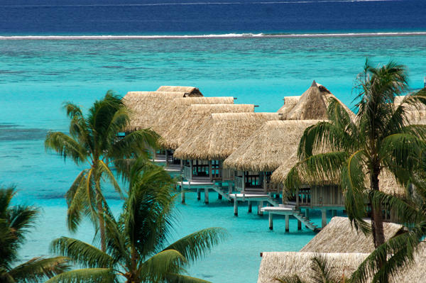 A beautiful view of the impressive overwater bungalows surrounded by crystal clear turquoise waters of Bora Bora.