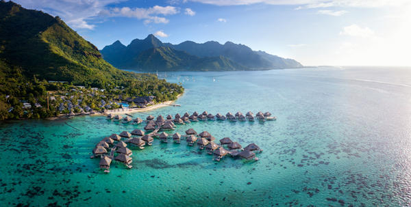 A beautiful complete aerial view of the entire Hilton Moorea Resort and its gorgeous overwater bungalows.