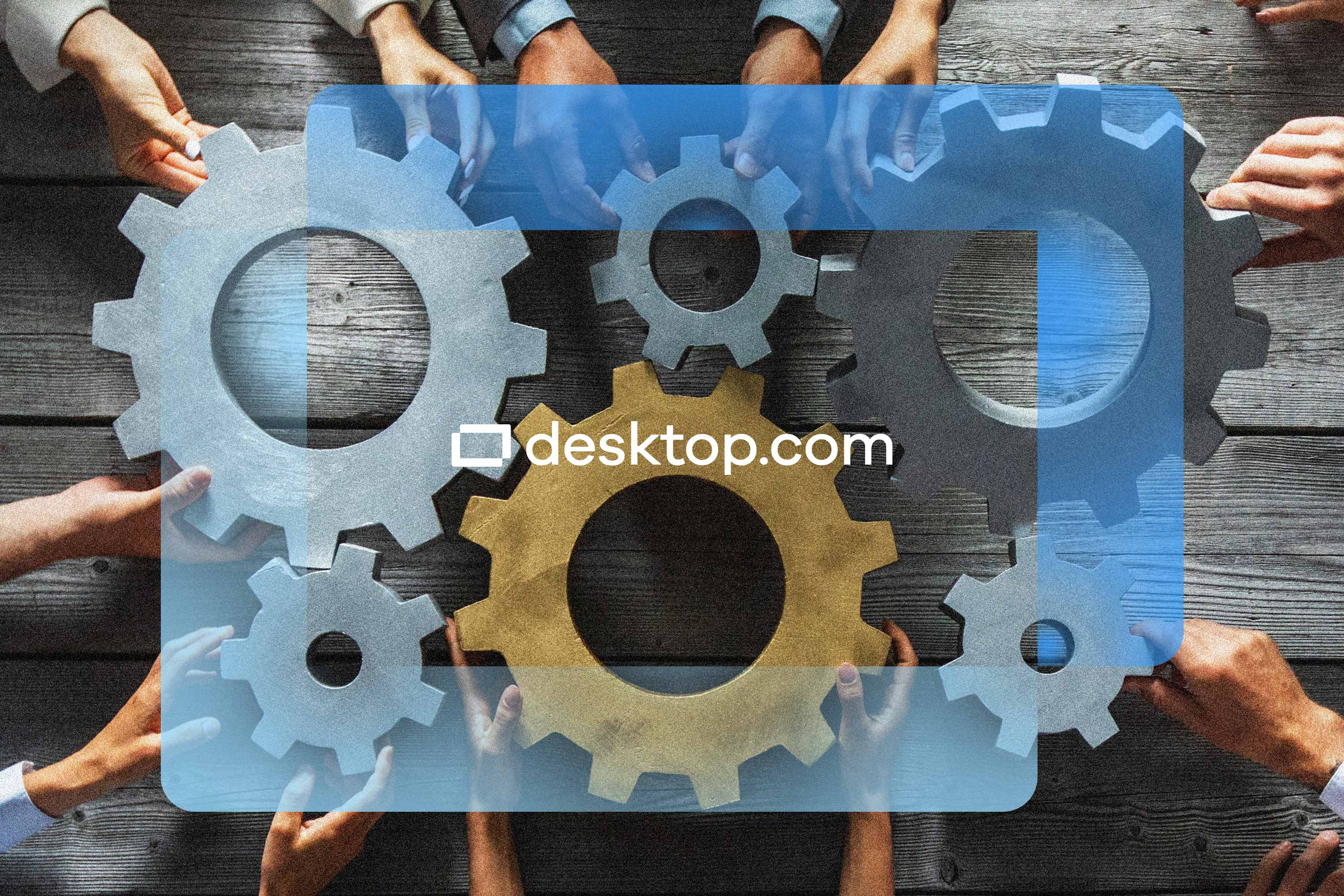 Hands handle gears on a wooden table with the desktop.com logo superimposed in the front
