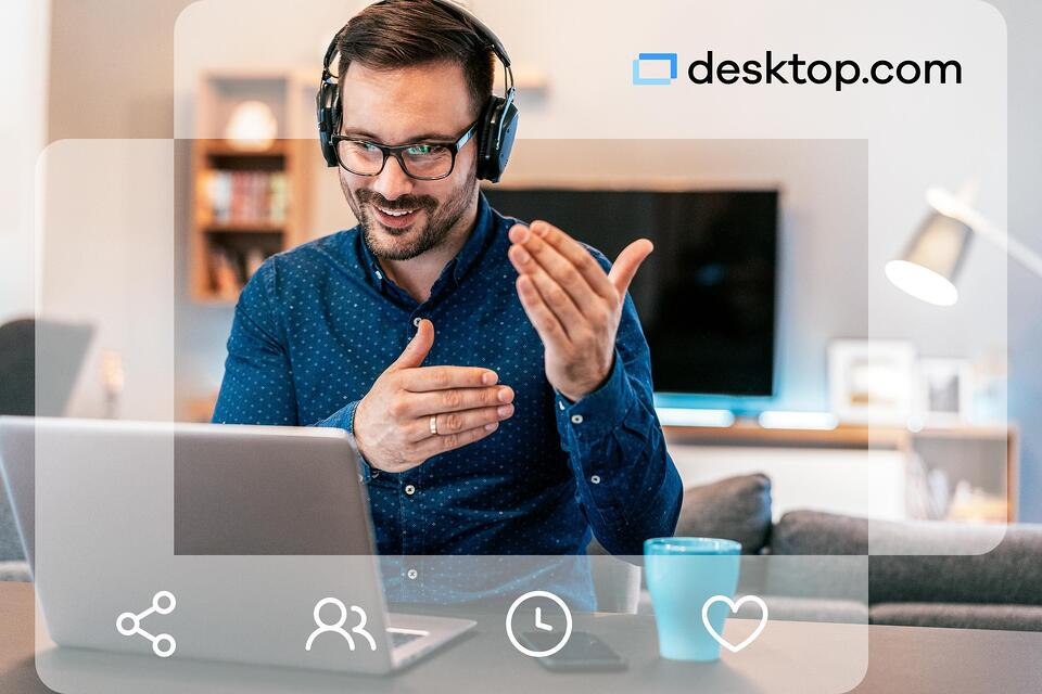 Man gestures in front of his computer wearing a headset