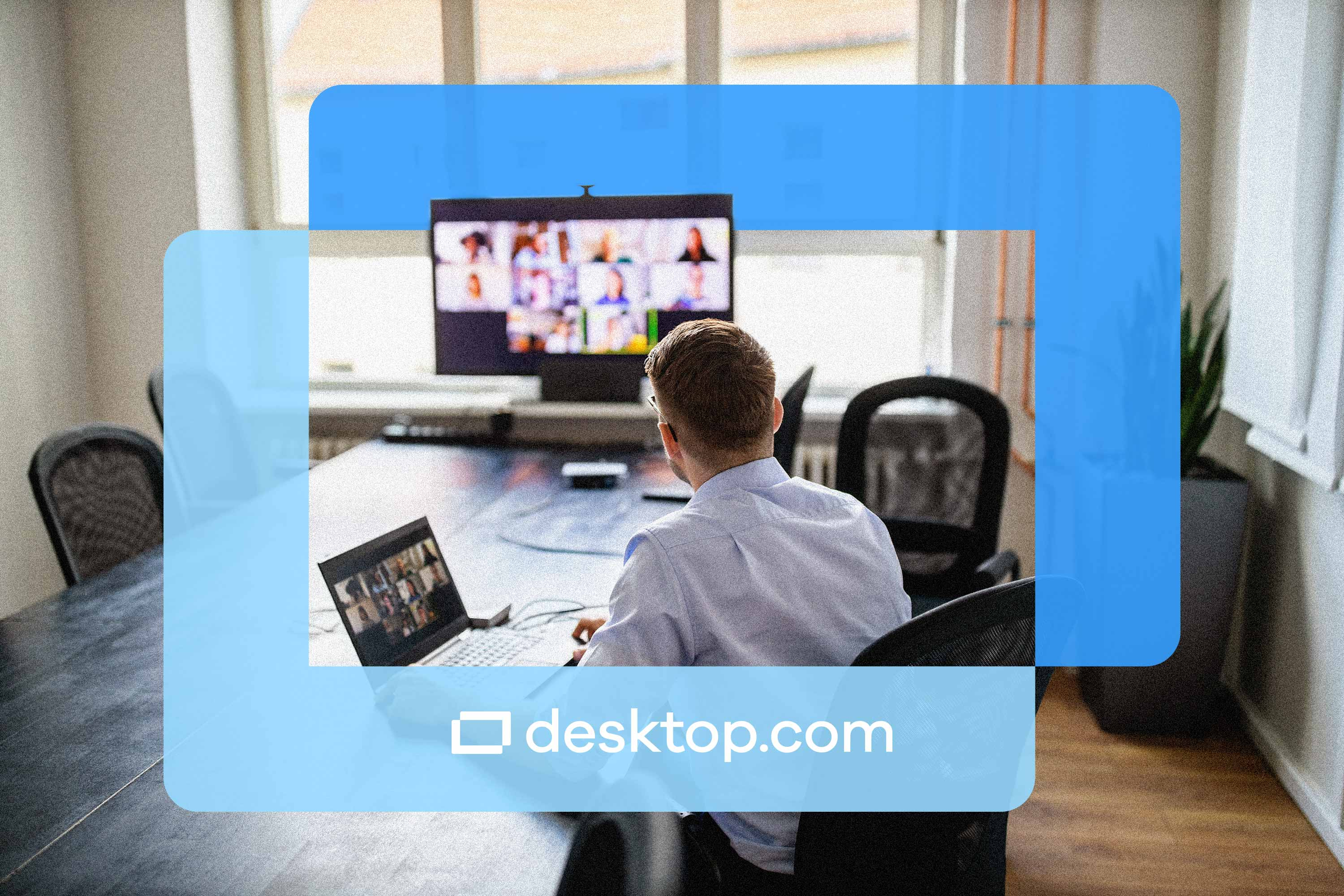 Man looks at computer screen with video meeting taking place