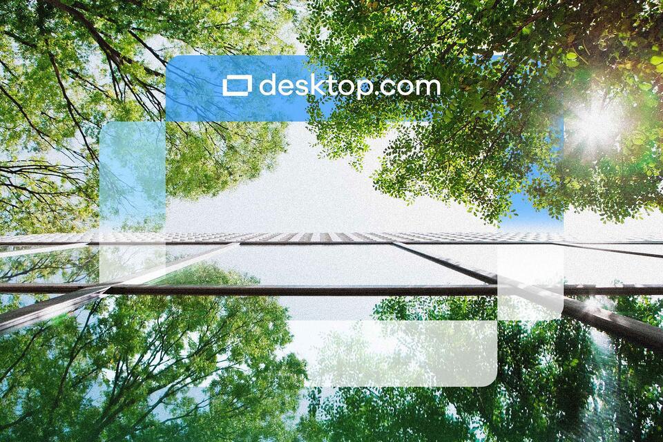 Desktop.com logo superimposed on tree tops and sky